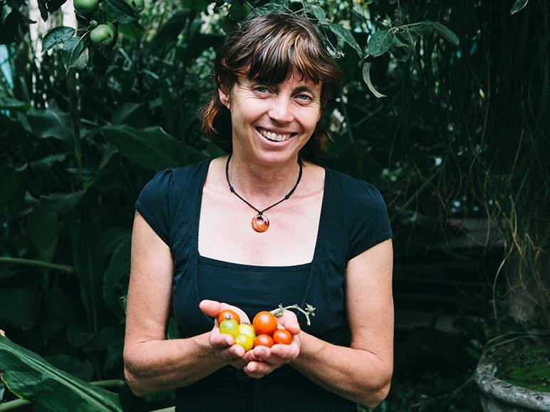 Karen with home grown tomatoes in the Gunyah garden