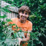Karen sutherland with tomato plants portrait