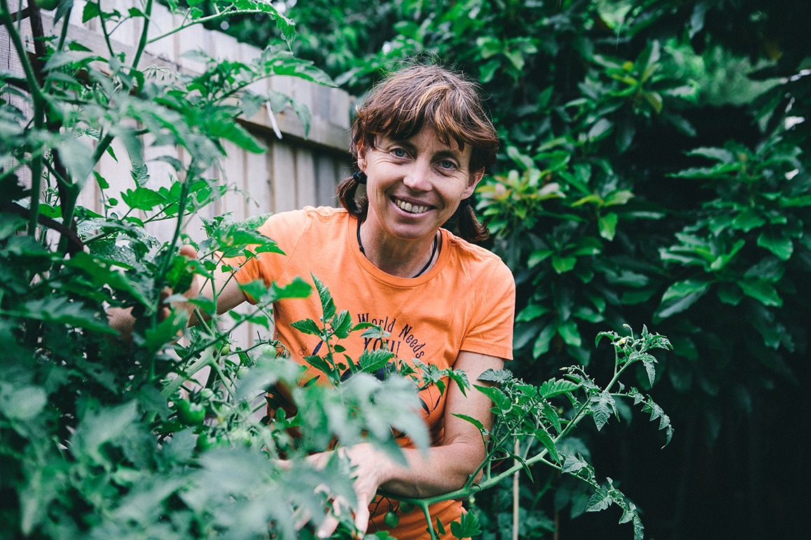 Karen sutherland with tomato plants portrait