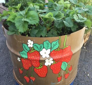 Pot of strawberries with painted strawberry artwork